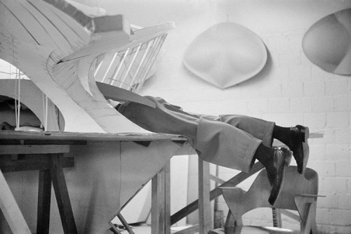 Eero Saarinen lying in the TWA model that was constructed inside the Saarinen office | 1956.