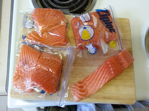 salmon = superfood! One 4oz serving provides your daily dose of omega-3s. I bought 2 lbs at whole foods and portioned it up into 8 pieces, which should work out to about 4oz each. Popped into ziplocs for easy storing in the fridge until I get a chance to cook them. Freezing raw fish is doable but you have to really vacuum seal it or else it will be ruined by freezer burn. Best to cook it all up, it will last 3-4 days in the fridge that way, or you can freeze it AFTER cooking it. Here's a neat guide that shows you food storage guidelines for all types of food: http://whatscookingamerica.net/Information/FreezerChart.htm