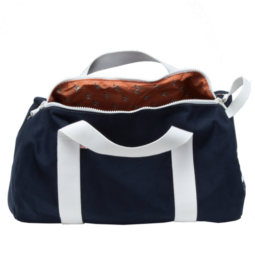 "We Got It For Free: Hudson Sutler St. Simons Duffel I love the canvas duffel bag. Headed out of town for the weekend? Going to a, uhm, friend's house for a sleepover? Throw some clean clothes and a sweatshirt in your duffel and hit the road. So when Hudson Sutler asked if we'd take a look at their St. Simons Duffel, I readily agreed. The St. Simons duffel is the basic weekend duffel size - 12"" in diameter and 22"" long. Like all duffels, it fits a surprising amount of stuff. In addition to the basic hand and shoulder straps, it's got a ""quick grab"" strap on one end, which is a neat addition. There's a convenient interior and an exterior zipper pocket. It's also got a great look in navy and white, with an orange hunting dog lining by William Lamb & Son. It's a very charming piece. As I loaded it with crap at my office that needed to go home, though, I wondered how far that charm would get me. The bag has a big-toothed plastic zipper that seems destined to break. The lining is great-looking, but lightweight, and I was immediately worried about soiling or tearing it. The bag's made in the USA, but it seems like aesthetics trumped the heavy-duty construction that's usually the hallmark of this sort of bag. There was nothing to make me wonder if the bag could handle an extra pair of pants and some socks and underwear, but I wouldn't subject it to more than a load of clothes. At $120, the bag is reasonably priced. It's a bit less than the classic competitor, William J. Mills & Co., who charge about $135. It's a fair bit more than my favorite, Oregon's Beckel Canvas, whose War Bag is about $85. Still, I love how it looks, and I'll certainly grab it the next time I've got a few extra clothes to tote around. (When I'm on my way to my seaside estate, for example.)"