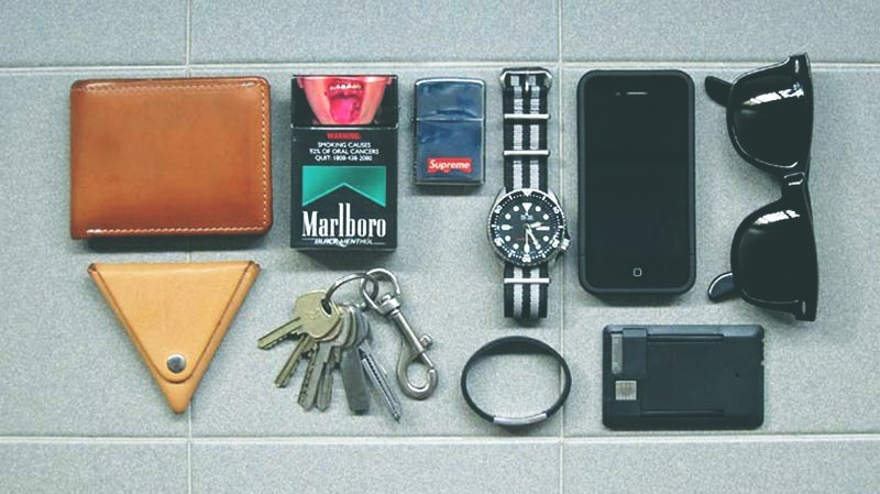 Submitted EDC By: Luthfi M. The daily necessities: Tanner Goods Bifold Wallet Zenok Leather Coin Pouch - Purchase on Esty Keys + LaCie USB + Utili-Key - Purchase on Amazon Zippo - Purchase on Amazon Seiko SKX007 + Nato Strap - Purchase on Amazon RoadID Bracelet iPhone 4S + Incase Slider Case - Purchase on Amazon 400mAh Charger/USB Connector/LED Torchlight Rayban Wayfarer - Purchase on Amazon