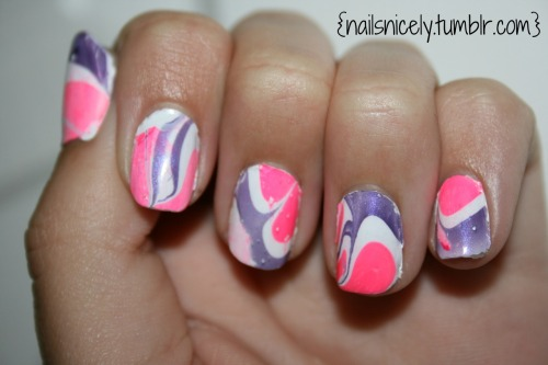Hello everyone! Here are my not so great water marble nails from a few weeks ago. I have two more designs to show you, but of course, my computer decided it would be a great thing to not let any photo editing software work. GRRRRR! So I will be working on that, but in the meantime, enjoy!
