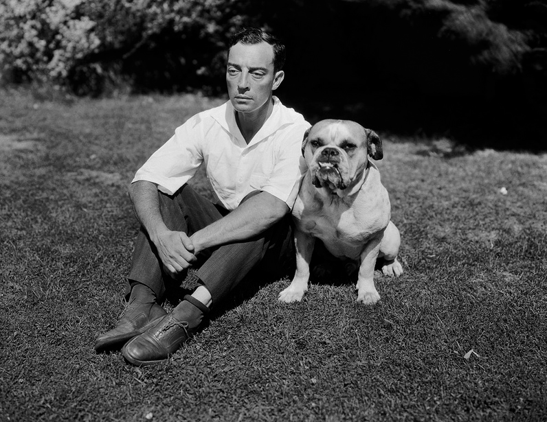 "kvetchlandia:  Uncredited Photographer     Buster Keaton with His Bulldog     1928 ""One who never smiled, carried a face as still and sad as a daguerreotype through some of the most preposterously ingenious and visually satisfying comedy ever invented. That was Buster Keaton."" James Agee, speaking of Buster Keaton in ""Comedy's Greatest Era,"" LIFE magazine, 5 September 1949"