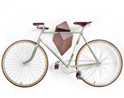 "madsuperherowannabe:  BIKE HANGER BY WOODSTICK Woodstick Ltd. introduces a handcrafted bike hanger that doubles as a work of art, featuring a multi-faceted design crafted from high quality oak. Available in cold black, light graphite, brown and natural color options, each style features an enhanced natural wood grain. Even better, the hanger can be installed on a variety of wall surfaces through a user-friendly mount system, utilizing just three standard screws. In the words of the guys from Woodstick, ""The product has its own special character from all viewing angles that makes this product simply special."""
