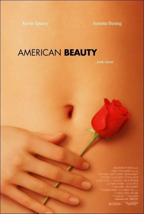 American Beauty (1999) is held as one of the best modern pieces of American Cinema and deservedly so. The main themes that is tackled seems to be the artificiality of the American Dream and materialism. Lester (Kevin Spacey) is a husband in a mid-life crisis who seeks out to do exactly what he wants, and tries to focus on what's important in life, (note the sofa scene).  The family made up of Lester, Carolyn (Annette Bening) and the daughter Jane (Thora Birch) are dysfunctional to the highest degree, the father hasn't spoken to his daughter in months and the mother is obsessed with success and appearance and seems to have also lost sight of what's most important, her daughter's upbringing.  The film attempts at symbolising their separation from each other by having each character lead a different narrative strand, they each go about their business, Carolyn has an affair whilst her Husband seems to have stood up for himself whilst he works out in an attempt to seduce his daughters friend Angela (Mena Suvari) whilst her daughter strikes a romance with the new neighbour Ricky (Wes Bentley). This works, and every on-screen confrontation between at least two of them seems to end in a huge argument. The ending for me was absolutely fantastic, one of my favourite, that moment where Lester (Spacey) sits down whilst starring in nostalgia at the old family picture, finally realising that what is most important is his family, the ending is an obvious metaphor, (spoilers) the death of Lester seems to represent the death of the American Dream, it puts to rest the ugliness and fake-ness of this symbol that was once created.  American Beauty (1999) sits as the 48th best film of all time in IMDB and for me the film represented Sam Mendes' past in theatre through his great use of lighting and direction, with the help of Conrad L.Hall of course.