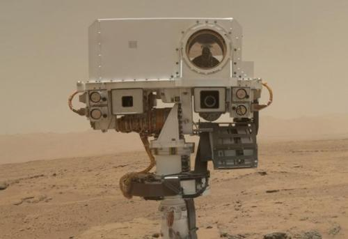 The main difference between NASA's Mars Curiosity rover and all your Facebook friends is that Curiosity takes pictures of itself and uploads them to the internet FROM MARS
