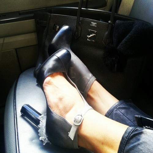 evachen212:  accessories of the day: now that I'm back in NYC, they're much more interesting. shoes by @chanel, bag by Hermes, pompom hat from New Zealand street fair  We can always expect a return with a bang!