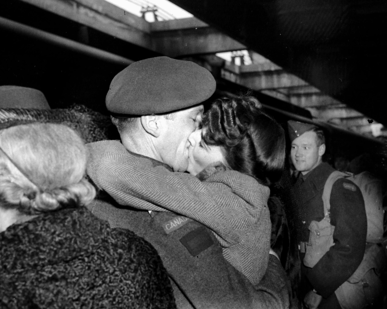 Kiss, 1944 A woman at the train station kissing a soldier who has just returned from a tour of duty overseas. Source: Photo by Jack Lindsay, City of Vancouver Archives #1184-623