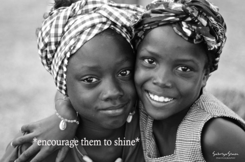 "~ Encourage them to shine… through it All ~ ♥ This image was taken after a Headwrapping Class with some of the Youth in Tivoli Gardens, Jamaica, on May 23, 2012… exactly two years after the ""Tivoli Incursion"". If you look closely at the princess on the left, you can see a stream of dried tears from each eye. She was crying a few minutes before I took this pic because another youth was playing a bit too rough with her.  After reasoning with her, I took a few pics of her before this one and showed her how she looked each time. A smile kept on growing pic after pic… until a friend of hers came and hugged her… and this was the moment captured :). Her own natural reflection and Love from a friend brought out such a beauty-full Light from withIn… even after tears."