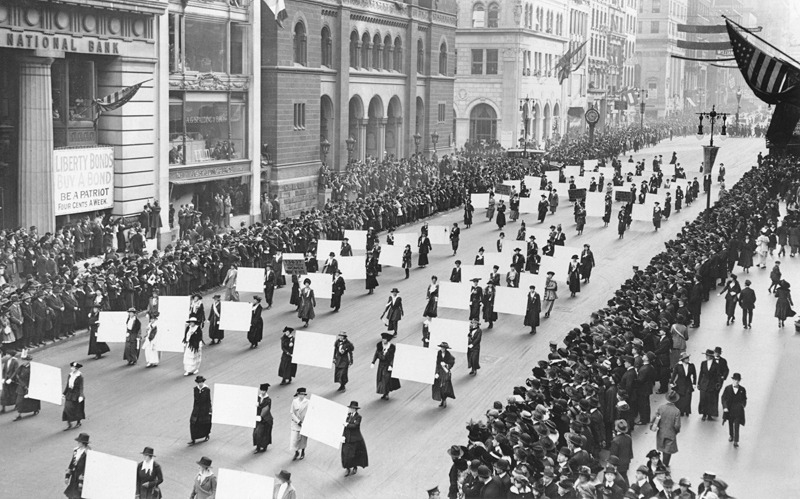 collective-history:  Women's suffragists parade down Fifth Avenue, New York, October 1917, carrying the signatures of a million women