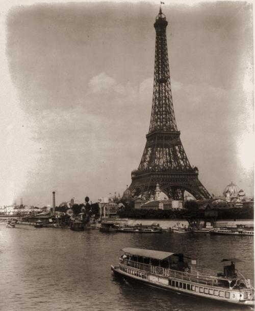 brikolazh:  Eiffel Tower and exposition buildings on the Champ de Mars, as seen from the River Seine, Paris Exposition, 1889