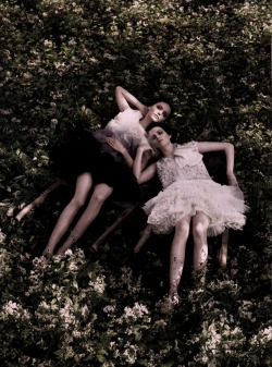 pradaphne:  Sasha Pivovarova and Karen Elson photographed by Steven Meisel for Vogue US December 2006.