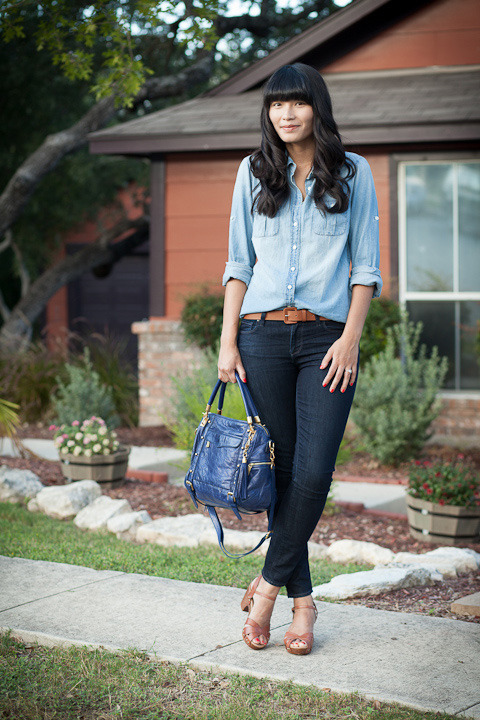 "2012. ode, canada. chambray perfect shirt by j.crew. verdugo leggings by paige. tanner belt (thrifted). miz mooz clogs.this is a very blogger-ish outfit. but i liked it and wore it twice over the weekend (saturday and sunday, boom). M's grandpa loved jean shirts; every christmas he asked for a new one from wal-mart. pop wore them with shorts or matching jeans and white sneakers. if pop were still here, i'd show him chambray boards on pinterest and he'd marvel at all the ""young"" people styling up his favorite shirt.when the denim on denim trend dies down, some of us will discard these shirts as relics of a bygone season. but i'll keep mine as a symbol of an important person, family holidays, and fond memories. besides, the canadians are onto something—- chambray goes with everything.the look 