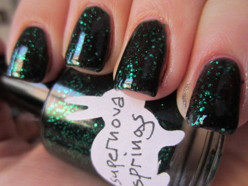 "hare polish ""supernova springs"" hey guys if you like hare polish, its going on sale on her etsy page in about 10 minutes! this is another one of my hare polishes and i'm so excited to get more! this is 3 coats and such a pretty black jelly with green glitter"