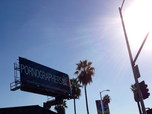 "On Condoms, Porn, and Billboards: Proposition B in Los Angeles I pass this sign every morning on my way to work, and I still can't get over how bizarre it is. At first glance, it may seem to be promoting a ""No on B"" stance. After all, it is relaying that pornographers, the people most affected by this law and who this law is intended to protect, are against it. But if you look at the fine print, it is paid for by the ""Yes on B"" campaign. What the ad is telling you is that pornographers ""Say No on B,"" and I guess the ""Yes on B"" people assume that no sane person would knowingly have any opinion in common with a pornographer. Which I suppose might be a legitimate tactic in some dry county in Alabama or something, but this is on Sunset Blvd. in Hollywood.  Proposition B would, in an effort to curb STD's and promote safe sex, require porn actors to wear condoms during filming. Actually, it requires that porn-makers apply for health permits from a government agency that can be revoked if they do not comply with the condom rule, among others. Yet again, government interferes with the consensual exchanges of free people for their own good. If this was something the porn industry or the porn-patronizing public wanted, it would already be taking place. And, because it is in their best interest to run a clean operation, the porn industry has checks in place to ensure their actors stay safe (and shooting shutdowns are prevented). Indeed, because of its regular screenings (every 14-30 days), there hasn't been a case of HIV in the industry since 2004 - and porn stars have lower infection rates than the public at large. But like all laws that meddle in the peaceful interactions of free people, if this proposition passes there will be unintended consequences. Instead of the desired outcome (of increased condom-use in porn), most filmmakers will simply move their operations where they can more accurately craft that which their customers demand: bareback shtupping. Many of the same meddlesome statists will no doubt weep at the lost tax ""revenue"" such departing businesses will represent.  Of course, this proposition isn't only about potential health risks to the tiny community of porn actors and their sex partners. There's also an element of legislating morality, one bureaucratic paper-cut at a time. So I guess it's fitting that stupid people use stupid billboards to promote stupid laws…"