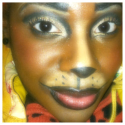 Here's a close up of my Halloween makeup. I used Urban Decay primer in Eden, Half Baked on the lid, and Perversion cut in the crease. Then I put gold NYX loose glitter on top. Used black cream liner on lips, brows,nose, and whiskers. Then I contoured/highlighted my face. Rawr.