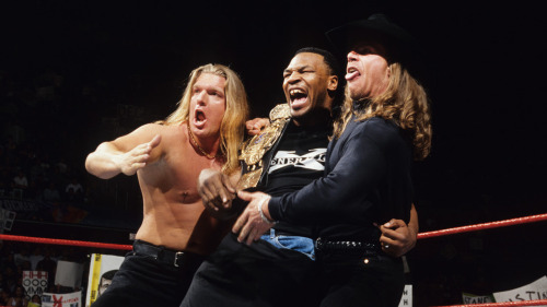 """Iron"" Mike Tyson Joins D-Generation X - WWF RAW is WAR [3/2/1998]  In another way to hype up the WrestleMania XIV main event between ""Stone Cold"" Steve Austin and Shawn Michaels, the WWF reached out to Mike Tyson to offer him a position as a special guest referee for the match. Austin (naturally) had an issue with this decision and made sure to voice his displeasure by shoving the ""Baddest Man on the Planet"" live on RAW. Tyson's role was changed to a special guest enforcer afterward which lead to this moment where ""Iron"" Mike shocked the world by revealing an alliance with D-Generation X."