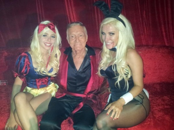 Trisha Frick (left) girlfriend of Hugh Hefner in Academy of Couture Art made Snow White couture Halloween costume. Enchanting! Thanks Academy of Couture Art designers Anna SOTNICHENKO, Laura KIRANI, Nikolle RAMIREZ MEJIA, Kym STYLZ, Valery MIRANDA, Emma CHEN, and Nicole GRANT