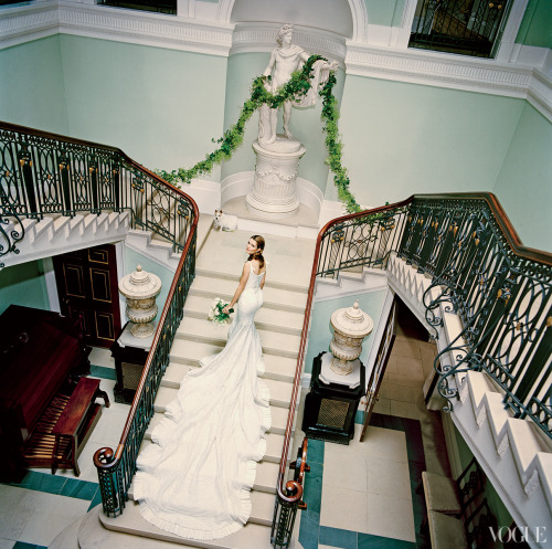 Plum Sykes on the staircase of her second cousin Sir Tatton Sykes's house Sledmere in Yorkshire, England, before her wedding to Toby Rowland in 2005. Alexander McQueen designed her dress. Photographed by Jonathan Becker, Vogue, January 2006