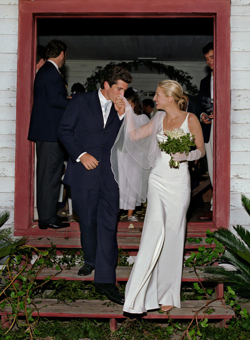 John F. Kennedy, Jr., and Carolyn Bessette Kennedy (in a pearl-colored silk crepe gown by Narciso Rodriguez) on Cumberland Island, off the coast of Georgia, in 1996. Photo: Denis Reggie, 1996