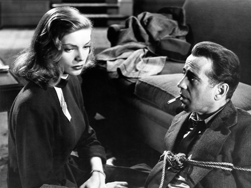 The Big Sleep inaugurates a post-modern, camp, satirical view of movies being about other movies that extends to the New Wave and Pulp Fiction. In that sense, it breaks fresh ground while sensing the ultimate dead end of the form. And so I have to say, ruefully, but with pleasure still, that The Big Sleep is both the most entertaining of films and a piece of shiny whimsy, untrue to life in so many important ways. After a hunderd years of film, intelligent commentary seems to be left with that embarrassing conclusion.