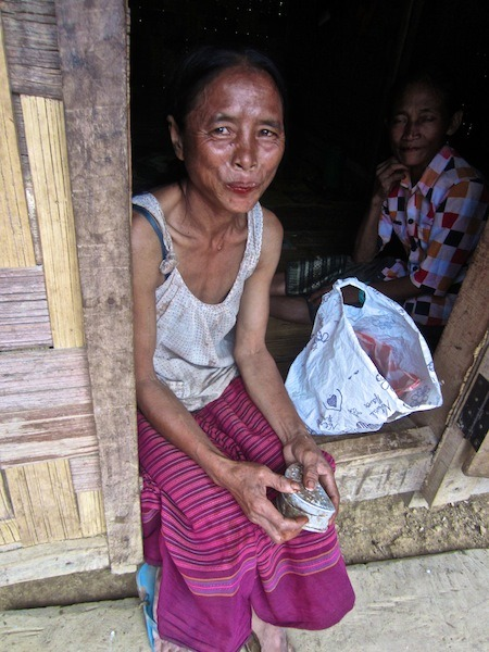 Village women enjoy chewing tobacco, Laos