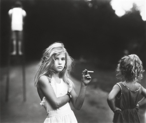 ambiguit-y:  Just handed in my case study on Sally Mann, who took this photo. About the controversy Mann had regarding her images because they were of her children all under the age of ten, nude (Immediate Family). She uses a 100year old 8x10 inch camera. Honestly the first thing that comes to mind, from a photographers point-of-view, is the shallow depth of field and the amazing black and white tone. Not only that, you try taking a picture using this type of camera and getting it so crisp and clear.
