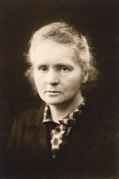 Today is the birthday of Marie Skłodowska-Curie (7 November 1867 – 4 July 1934), a Franco-Polish chemist and physicist famous for her pioneering work on radioactivity with her husband, Pierre Curie.   When the Curies saw radium glowing in a test tube at the turn of the last century, they knew that they were seeing something new for which no word existed.  The word they coined, radioactive, was a combination of the Latin word radius meaning a ray and the French word actif from the Latin word actus meaning a doing, a driving, impulse; a part in a play.  The Curies were attempting to convey what they were seeing-energy radiating out from the material.  Today, radioactive decay is defined as the process by which an atomic nucleus of an unstable atom loses energy by emitting ionizing particles.  There are many types of radioactivity classified today, but all fall under the larger definition of activity radiating out in rays.  Image of Marie Curie in the public domain.