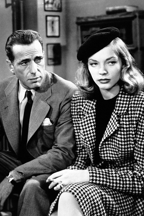 While filming To Have and Have Not, Humphrey Bogart became enchanted with Lauren Bacall. This became apparent, according to Bacall, about three weeks into the shooting of the picture. Immediately it presented problems, because Bogart was still married to Mayo Methot, who was as watchful and as jealous as ever. A few weeks earlier, when he was congratulating Bacall on her screen test (which consisted of the famous 'If you want me, just whistle' scene), his prescient comment had been 'We'll have a lot of fun together,' but for a while it seemed as if fun was the last thing on their agenda: they would drive their cars to secluded residential streets and sit holding hands and talking, or write each other long, ardent, frustrated letters. And when shooting on To Have and Have Not was over, they had no further excuse for being together. Fortunately fate was quick to step in, in the kindly guise of Howard Hawks and Warners executives, who were so pleased with the on-screen chemistry between the two stars that they decided to waste no time before pairing them again. In October 1944 they began filming their second film The Big Sleep where they resumed their affair with a vengeance.