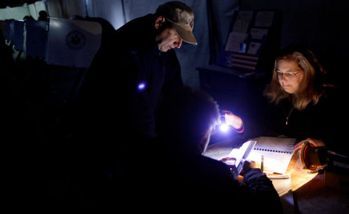 wnyc:  Image of the day so far: voting by flashlight in a makeshift polling tent on Staten Island. (via NYTimes) -Jody, BL Show-   make sure you vote today, tumblr people!and if you're in the NJ/NY area, good luck and let us know how it goes.