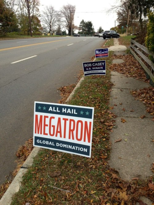 "All Hail Megatron, Transformers Themed Political Yard Sign From an image shared on Imgur, redditor BergerKing80 posted about this Transformers themed political yard sign that reads ""All Hail Megatron – Global Domination."" You can download a Facebook timeline header image created by redditor nerdwithme (as seen below) that is based off of the original All Hail Megatron yard sign. Remember, vote Megatron 2012!  via reddit, geekpr0n and Laughing Squid"
