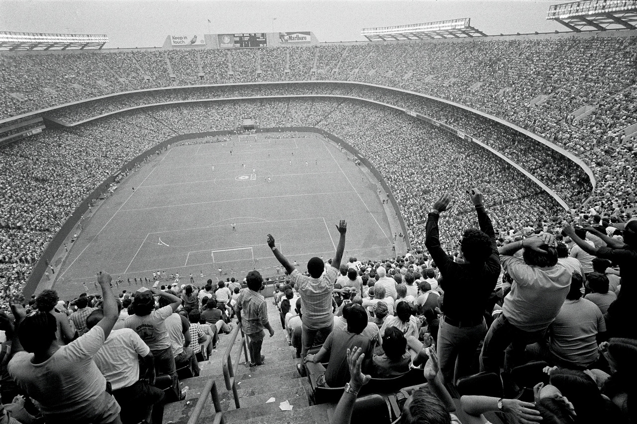 74,901 fans fill Giants Stadium in East Rutherford, New Jersey, to watch the New York Cosmos defeat the Tampa Bay Rowdies in Soccer Bowl '78. To date, this remains the largest crowd for a professional soccer championship game in North America. Photo Credit: Joe McNally, http://portfolio.joemcnally.com/