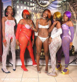 dem lingerie ladies poses with a yuck fouing one in the middle.