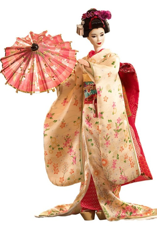 "Maiko™Barbie® Doll Inspired by Japanese customs that started centuries ago, Maiko™ Barbie® doll represents the ""flower and willow world"" that is geisha society. Her bright kimono has long, flowing sleeves and her wide, elaborate obi (or sash) ties in the front. With white makeup, a traditional hairstyle, white socks and Japanese sandals, she's the picture of femininity."