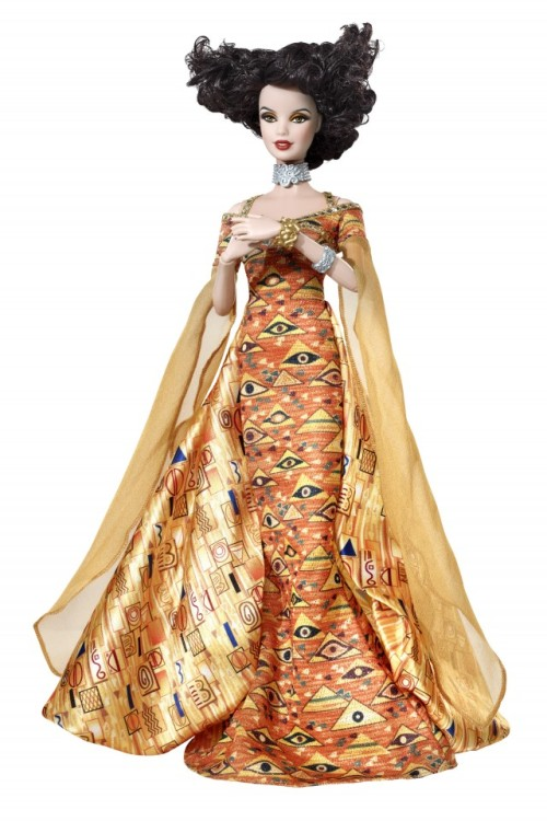 Barbie® Doll Inspired byGustav Klimt An amazing fusion of fashion and fine art, the Museum Collection dolls are a feast for the eyes! Gustav Klimt Barbie doll echoes the artist's portrait, Adele Bloch-Bauer I, reflecting the painting's Byzantine mosaics and Egyptian motifs. She wears a halter gown with silvery trim, draped chiffon sleeves and bustle, as well as silvery choker and cuffs, and her curly parted hair and posable hands suggest the original. She is a magnificent muse both in and out of her exquisite packaging.