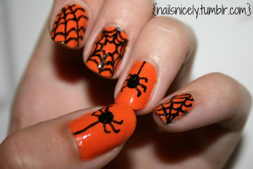 I know this is late, but here are my halloween nails! Inspiration for these are right here! There is even a nifty little tutorial that I did not know about! Enjoy!
