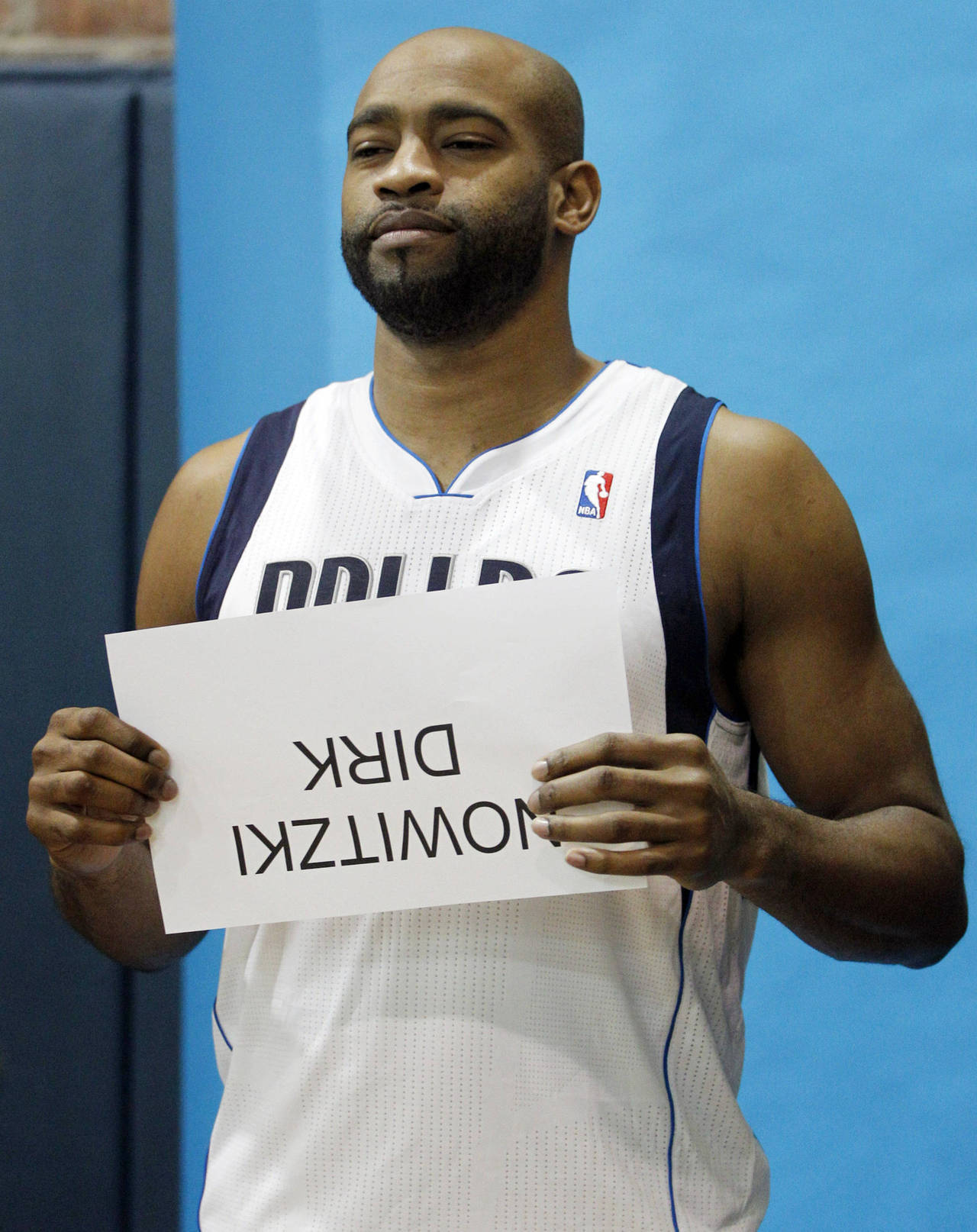 Vince Carter can't even give full effort during Photo Day. That, or he's become Half Man, Half Dyslexic. Seconds later, the camera flash went off and Carter fell to the ground grabbing his knee and yelling for a foul. (AP Photo/LM Otero)