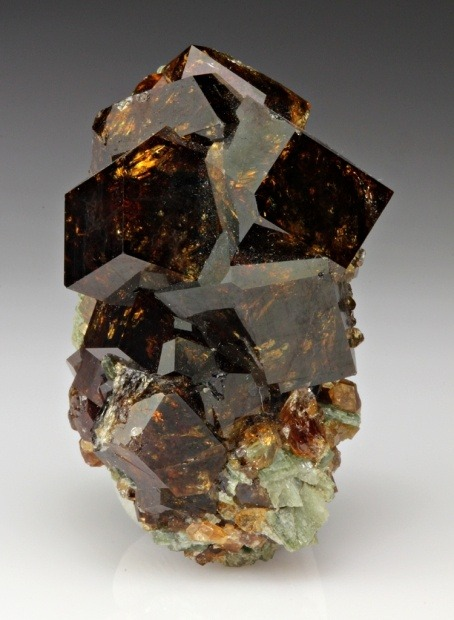 Brown Garnet Grossular Crystals ♥ Passion ♥ Sensuality ♥ Sexuality ♥ Romantic love ♥ Intimacy ♥ Positive thoughts ♥ Energy ♥ Past life recall ♥ Inspiration ♥ Success ♥ Social popularity ♥ Self-confidence Chakras -  Base Chakra, Heart ChakraBirthstone -  JanuaryZodiac -  Aries, Leo, VirgoPlanet – MarsElement – FireTypical colours - Most often seen in red, but available in virtually all colours, including: pink, green, orange, yellow, brown and black Garnet cleanses and re-energises the chakras.  It revitalises, purifies and balances energy, bringing serenity or passion as appropriate.  Inspires love and devotion.  Garnet balances the sex drive and alleviates emotional disharmony.  It activates and strengthens the survival instinct, bringing courage and hope.  Stimulates past-life recall.  Sharpens perceptions of oneself and others.  Garnet removes inhibitions and taboos.  It opens the heart and bestows self-confidence.