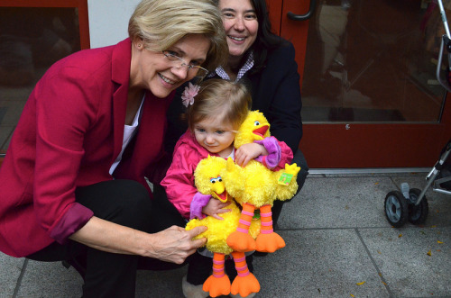 Elizabeth Warren and Big Birds and a little girl in Gloucester, Mass., on Halloween. (Flickr)