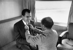 life:  LIFE photographer Alfred Eisenstaedt adjusts Richard Nixon's tie prior to photo shoot during the 1960 presidential campaign. Nixon lost to JFK in November of that year by one of the smallest margins in American history. See more here.