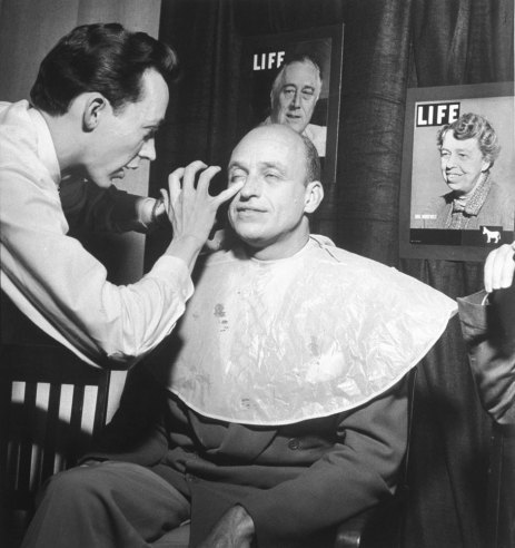 Franklin D. Roosevelt's oldest son, James, gets makeup for a television broadcast during the 1948 Democratic National Convention in Philadelphia, Penn. See more here.