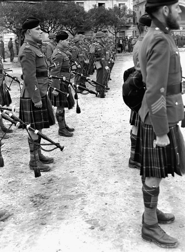 fuckyeahcanadianforces:  Soldiers of the Seaforth Highlanders of Canada and the Lorne Scots taking part in the Changing of the 1st Canadian Corps Guard ceremony, Rocca, Italy, 1 March 1944. Stirton, Alexander Mackenzie, 1915-, Photographer