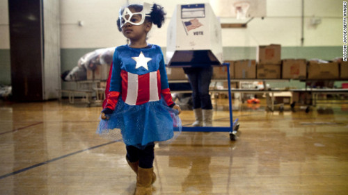 Raena Lamont, 3, wears a Captain America costume at a polling center Tuesday in Staten Island, New York. The polling station doubles as a donation site as Staten Island works to recover in the aftermath of Superstorm Sandy.