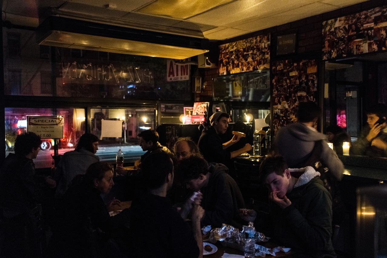 Pete Wells of the New York Times issues a call to action: Downtown needs diners now     This is a big hit for businesses that get by on small margins, and for workers who are often paid by the hour. A few places may not survive. All will struggle…   Not one of these establishments requires help as desperately as a family whose home was destroyed by water, fire or wind. Basic food and shelter are urgent requirements for many New Yorkers this week.   But a city where doing many things at once is as natural as breathing can certainly help out more than one cause at a time. Right now, these restaurants, the people who own them and, even more, the people who work for them, need us. And we need them. Downtown's restaurants show us who we are.   Read the rest of his editorial here.  The photo above was taken at East Village Pizza on 1st Avenue near 9th street. It was one of the few places open during the blackout that I saw in East Village.