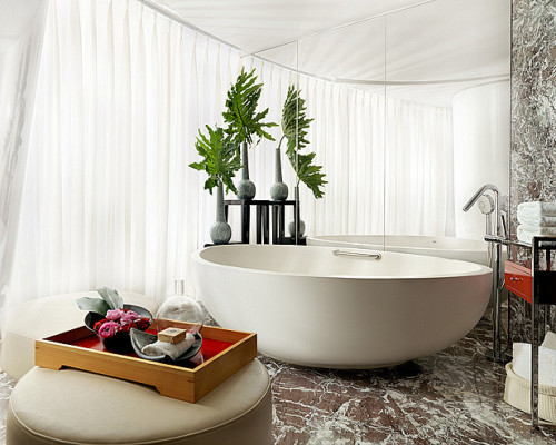 I want this bathroom.   musesofdesign:  Stunning Synergy Leading Australia stone composite bathware manufacturer Apaiser has completed the supply of its stunning baths for the Four Seasons Hotel Guangzhou, a stunning new architectural landmark in China's southern provincial capital and the brand's 88th property worldwide. Remarkable for both its soaring height and tapering avant-garde design, the newly opened hotel is set to become a new benchmark for interior design in Asia.  Working with HBA's interior design team based in Singapore, Apaiser created two unique bath solutions for the challenging design brief, upholding the integrity of the Four Seasons brand coupled with innovative design and sensitivity to location.