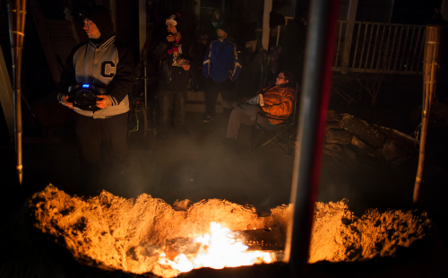 buzzfeed:  Residents of Rockaway Beach, NY stand by a fire listening to the election on a radio.  The people of Rockaway Beach have been hanging tough lately, and tonight some are  hanging on an election as well. A simply great photo.