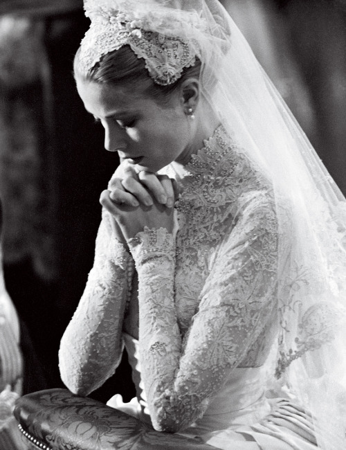 suicideblonde:   Grace Kelly, in a gown by MGM costume designer Helen Rose, kneeling at the altar during her wedding at Saint Nicholas Cathedral to Prince Rainier III of Monaco in April 1956