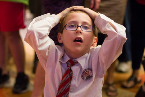 Eight-year-old Draak Clausing, attending a Republican election-watch party in Arizona, holds his head in despair as election results continue to stream in indicating an Obama re-election. (Photo by Aaron Lavinsky for the Arizona State Press)