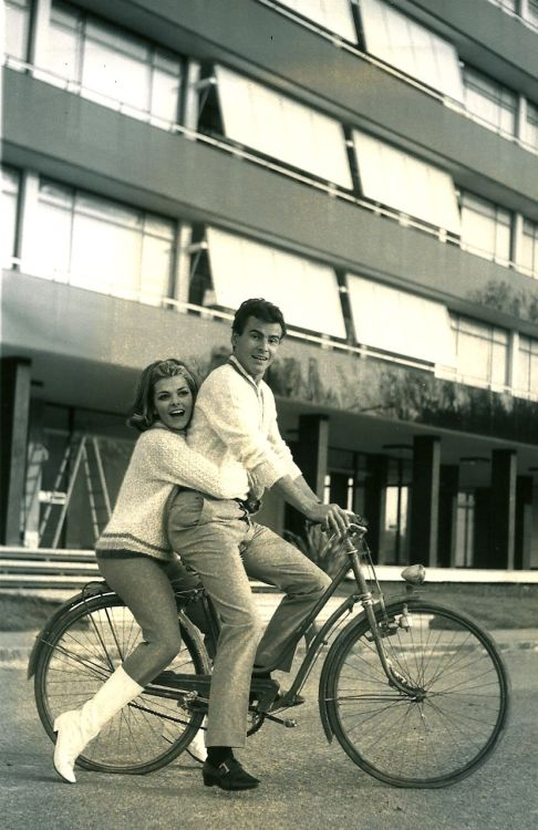 Horst Buchholz and Perette Pradier ride a bike.