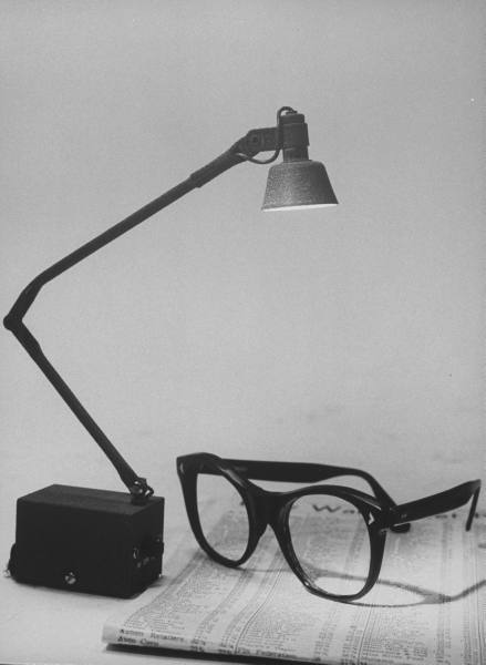 Modern table lamp and eye glasses, circa 1964.