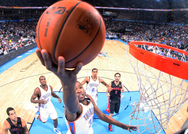 Thunder forward Kevin Durant swoops to the hoop during Tuesday's game against the Raptors. Durant scored 15 points as Oklahoma City rolled to a 108-88 victory. (Layne Murdoch/NBAE via Getty Images) POWER RANKINGS: Thunder slide to No. 5 as Knicks slide into No. 3 slot